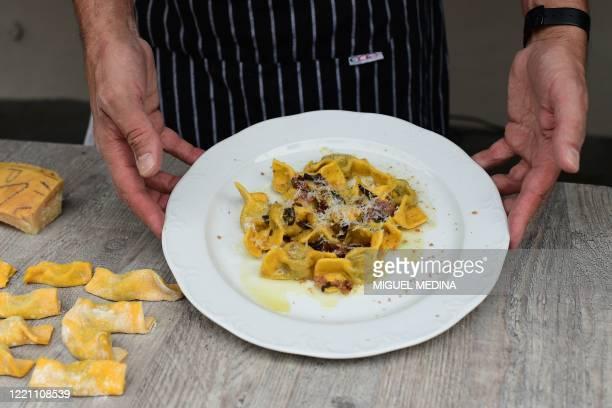"""Chef Samuel Perico, of the 'Trattoria Sant'Ambroeus' in Bergamo's upper city, shows typical pasta dish """"I Casoncelli"""" on June 16, 2020. - Bergamo,..."""