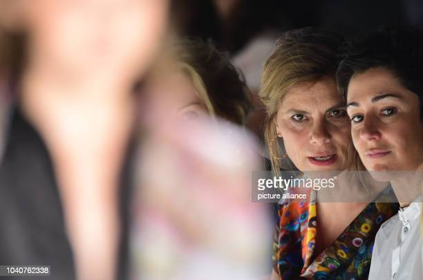 TVchef Sarah Wiener and TV host Dunja Hayali attend the show of fashion label Anja Gockel during the MercedesBenz Fashion Week in Berlin Germany 08...