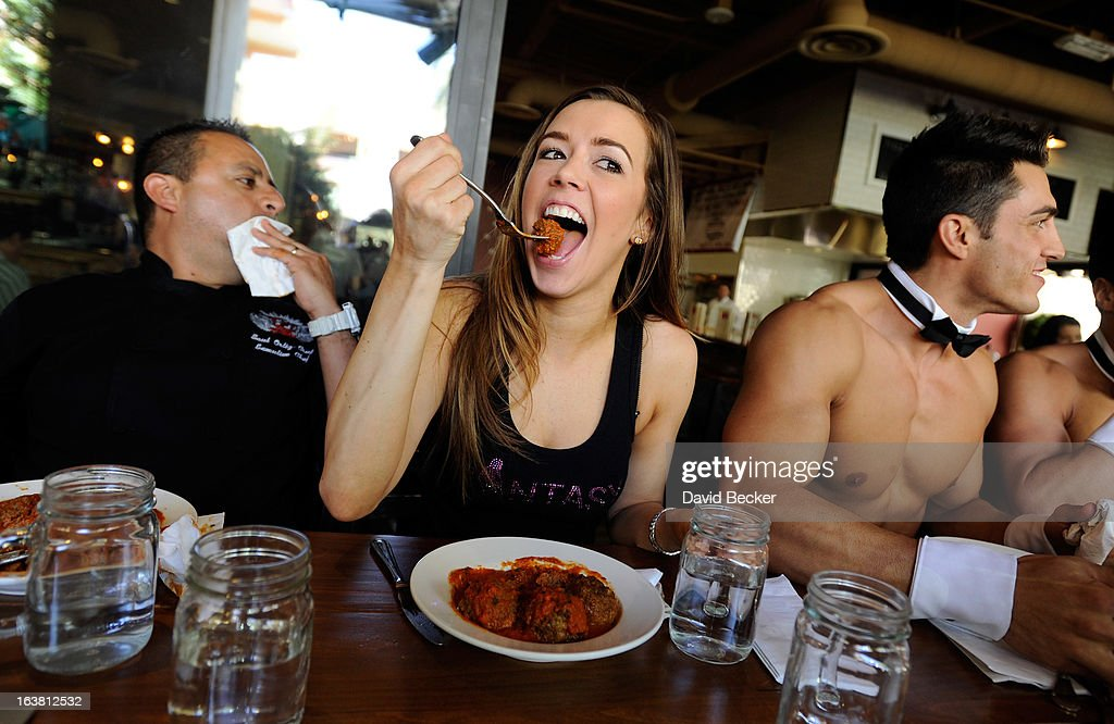 Chef Saul Ortiz-Cruz, Mariah of the production show 'Fantasy' and Chippendales dancer Jon Howes appear at the meatball eating contest at the Meatball Spot on March 16, 2013 in Las Vegas, Nevada.