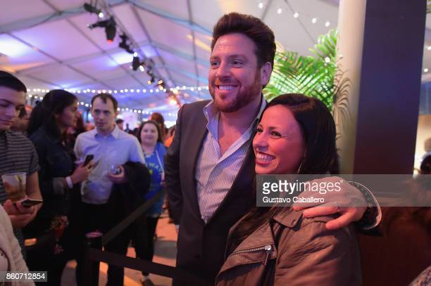 Chef Scott Conant poses with a fan at The Food Network & Cooking Channel New York City Wine & Food Festival Presented By Coca-Cola - Smorgasburg...