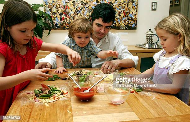 Chef Sean Connelly making pizzas with his 3 children in their Randwick home Children from left to right are Eliza Toby and Kiera 2 July 2004 SMH GOOD...