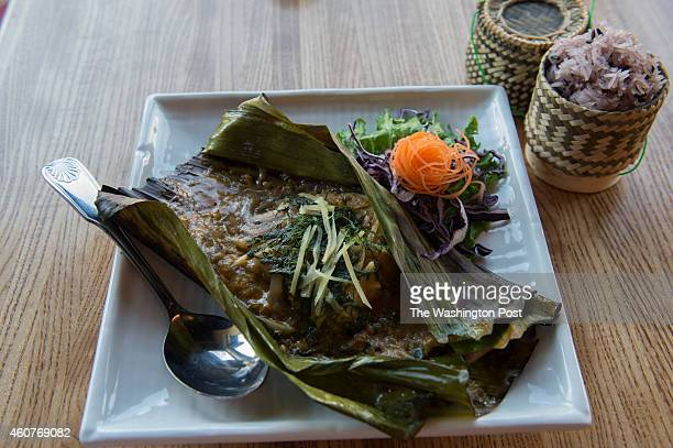Chef Seng Luangrath's Laotian restaurant Thip Khao features grilled Chilean Sea Bass wrapped in a banana leaf with fresh dill on December 17 2014 in...