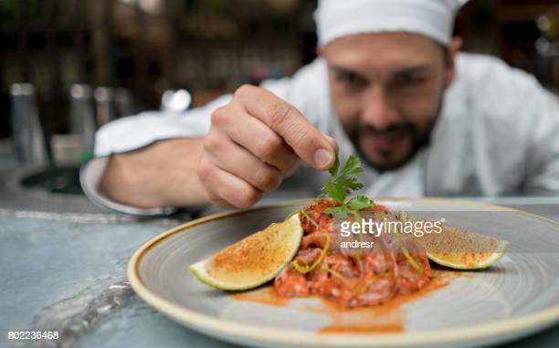 Chef serving a plate at a restaurant