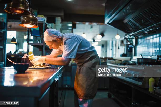 chef serving food - restaurant stock pictures, royalty-free photos & images