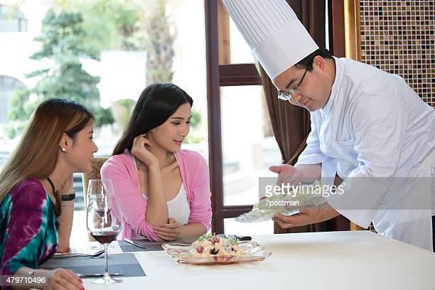 Chef serving fresh salad
