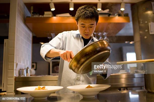 Chef serving pasta into plates