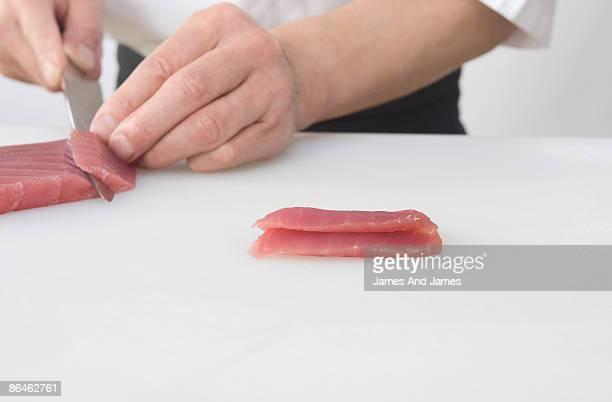 Chef slicing tuna