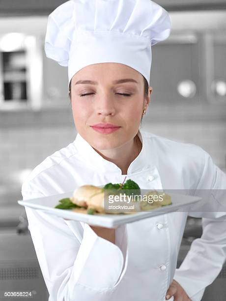 Chef smelling chicken dish