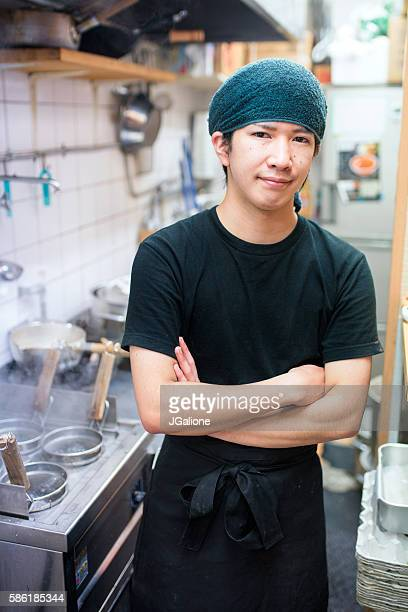 Chef stood in his kitchen