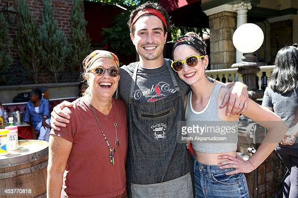 Chef Susan Feniger actor Ben Feldman and his wife Michelle Mulitz attend Crab Cake 2014 presented by S Pellegrino Samsung Galaxy on August 17 2014 in...
