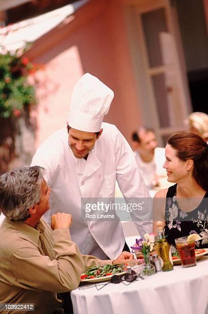 Chef talking to patron