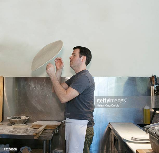 Chef throwing  pizza dough