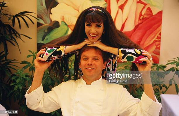 Chef to the stars Wolfgang Puck playfully poses with his wife and business partner Barbara Lazaroff in this 1986 West Hollywood California photo at...