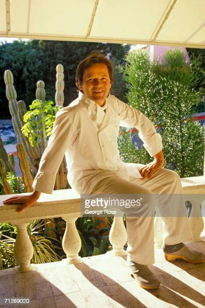 Chef to the stars Wolfgang Puck poses in a 1989 portrait on porch of his famous West Hollywood California restaurant Spago Each year Puck creates the...