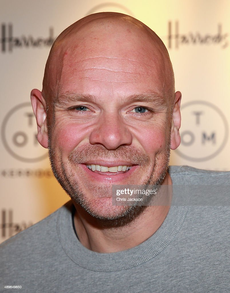 Tom kerridge book signing photos and images getty images chef tom kerridge poses with a copy of his book toms table my favourite forumfinder Choice Image