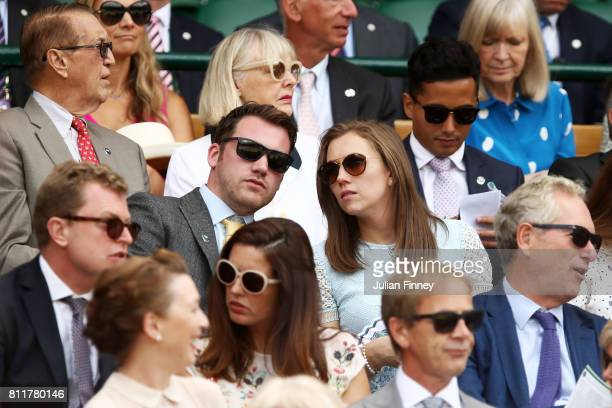 Chef Tommy Banks and Charlotte Kenney look on from the centre court royal box on day seven of the Wimbledon Lawn Tennis Championships at the All...