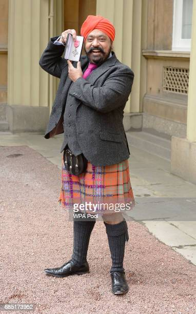 Chef Tony Singh poses after he was awarded an MBE by the Prince of Wales during during an Investiture ceremony at Buckingham Palace on May 19 2017 in...