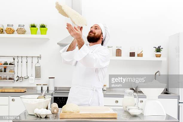 Chef tossing dough