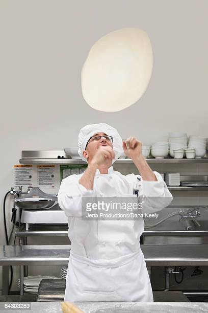 Chef tossing pizza dough