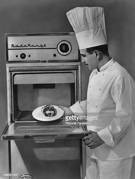 A chef using a Raytheon Radarange III an early commercial microwave oven circa 1958