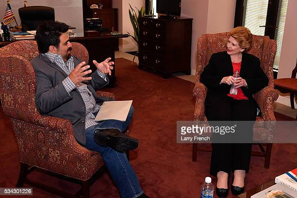 Chef Victor Albisu speaks with US Senator Debbie Stabenow on Capitol Hill during a day of action by some of the nation's top chefs and food waste...