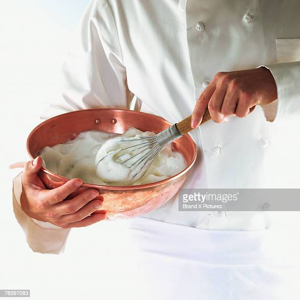 Chef whipping meringue