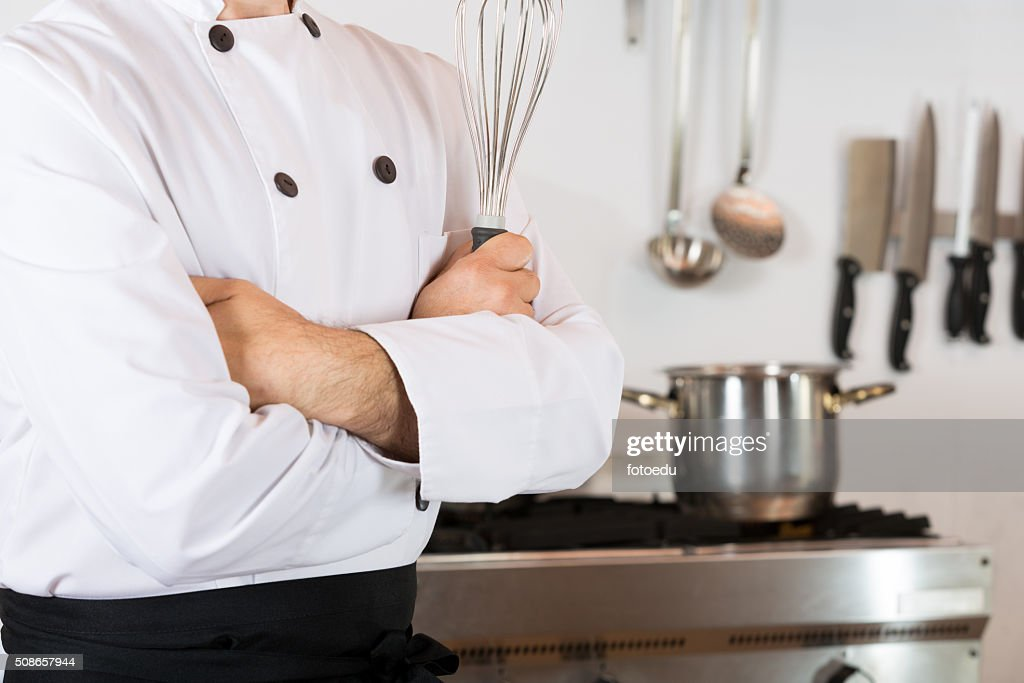 Chef with a whisk : Stock Photo