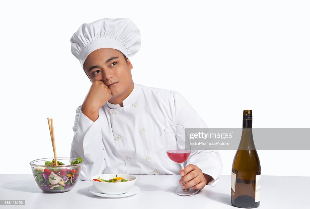 Chef with glass of wine thinking : Stock Photo