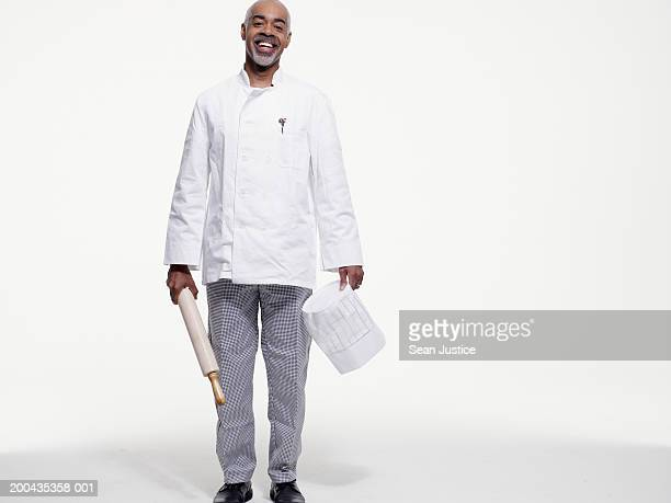 Chef with rolling pin smiling, portrait