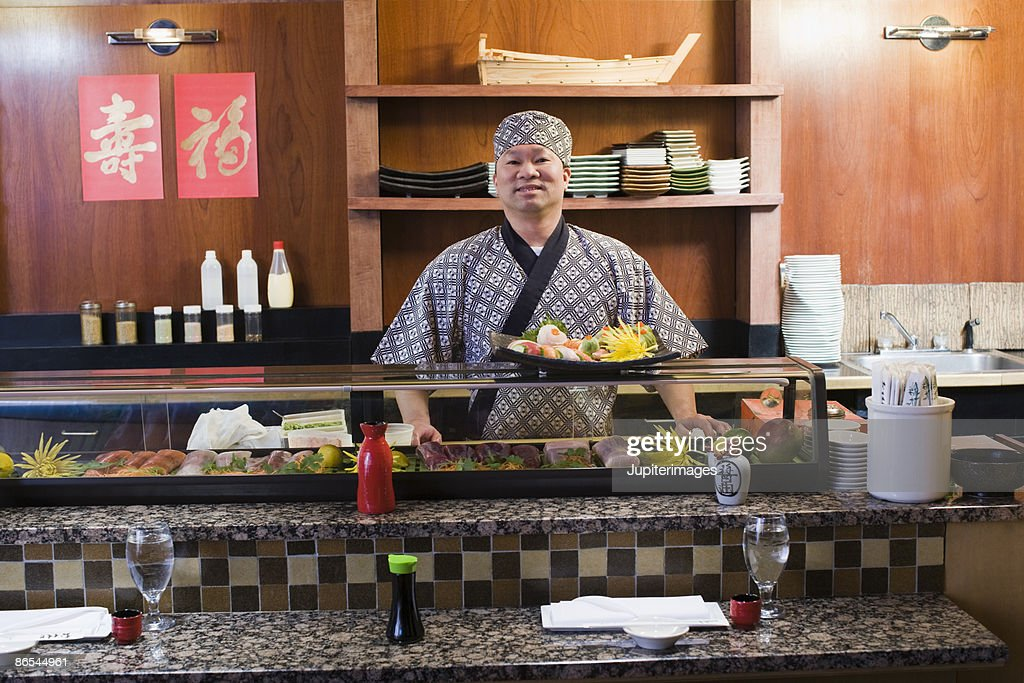 Chef with sushi : Stock Photo