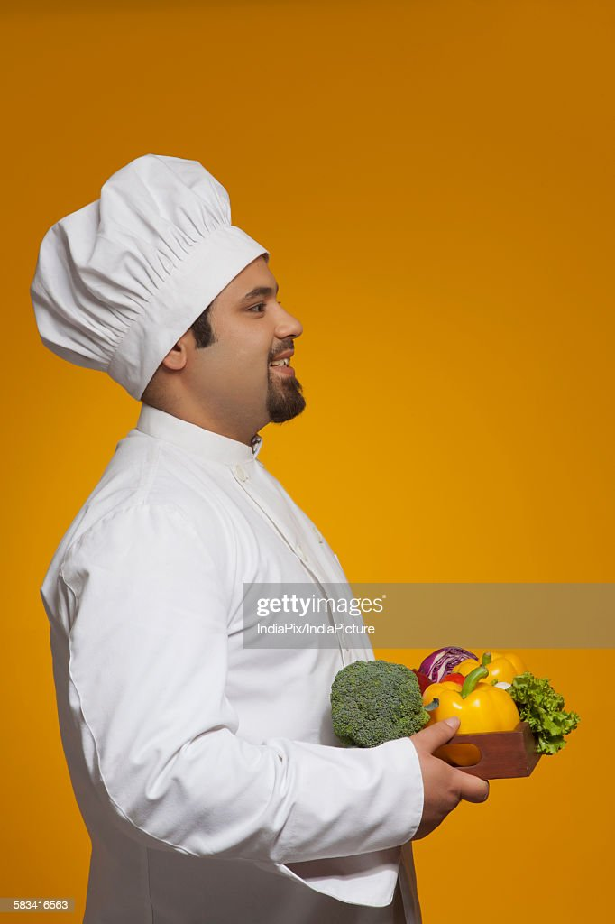 Chef with tray of vegetables : Stock Photo