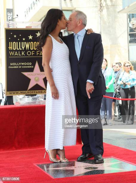 Chef Wolfgang Puck and wife designer Gelila Assefa attend his being honored with a Star on the Hollywood Walk of Fame on April 26 2017 in Hollywood...