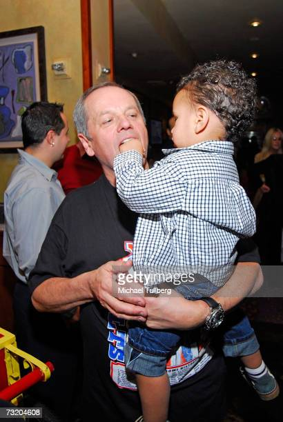 Chef Wolfgang Puck is fed popcorn by son Oliver at the Super Bowl Bash at Spago at Wolfgang Puck's Spago restaurant February 4 2007 in Beverly Hills...