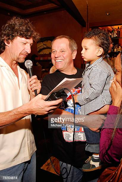 Chef Wolfgang Puck is interviewed for The Howard Stern Show as son Oliver looks on at the Super Bowl Bash at Spago at Wolfgang Puck's Spago...