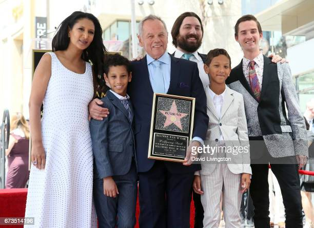 Chef Wolfgang Puck posing with wife designer Gelila Assefa and his sons is honored with a Star on the Hollywood Walk of Fame on April 26 2017 in...