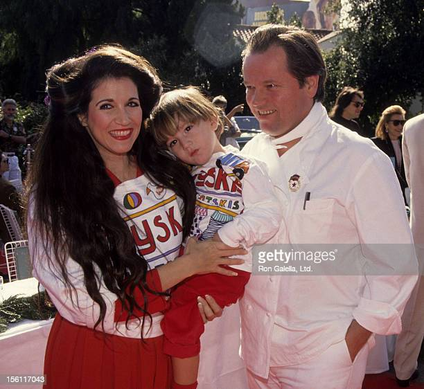 Chef Wolfgang Puck wife Barbara Lazaroff and son Cameron Puck attend First Annual Toys For Tots Benefit on December 14 1991 at Spago Restaurant in...