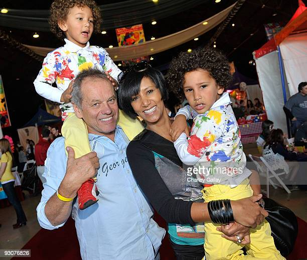 Chef Wolfgang Puck, wife Gelila Assefa, and children Oliver and Alexander attend P.S. Arts Express Yourself 2009 at Barker Hangar at the Santa Monica...