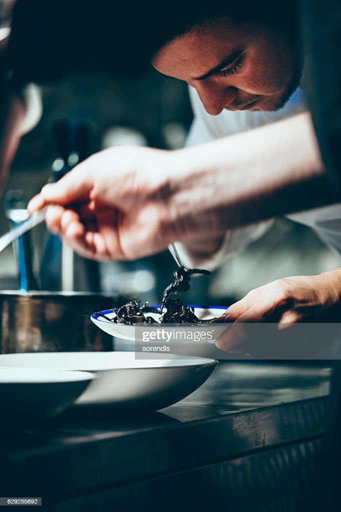 Chef working in a commercial kitchen : Stock Photo