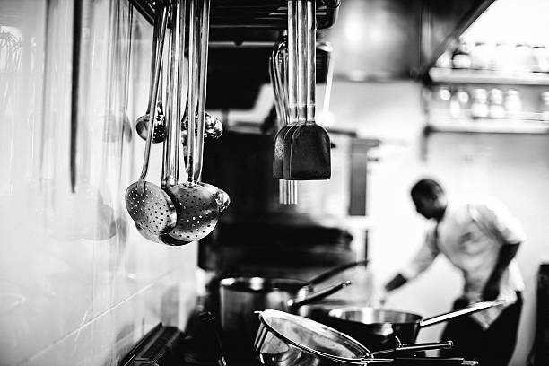 Chef working in a kitchen black and white