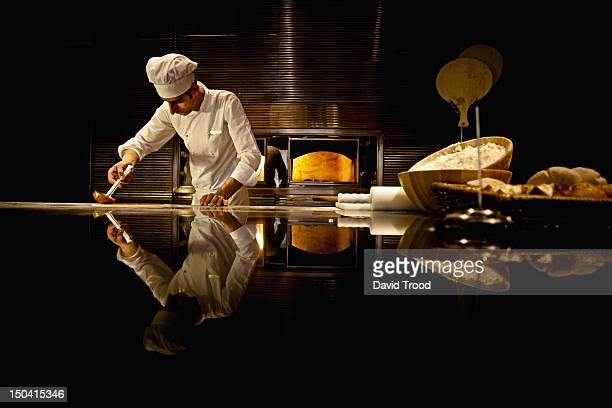 Chef working in industrial kitchen.