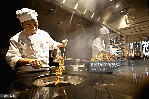 Chef working in industrial kitchen.