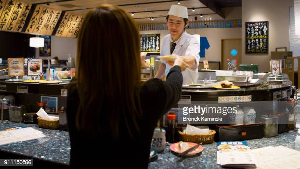 A chef works in a sushi restaurant / Tokyo, Japan