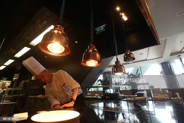 A chef works in the open kitchen at the InterContinental Hotel Davos operated by InterContinental Hotels Group Plc ahead of the World Economic Forum...