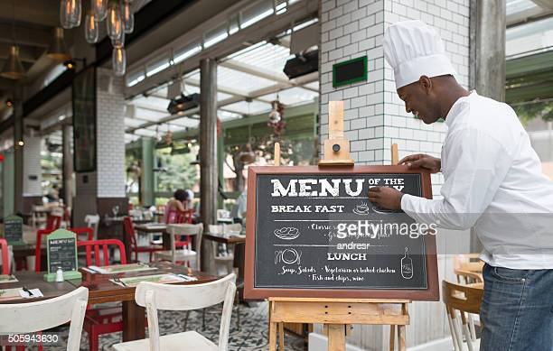 chef writing the menu at a restaurant - menu stock pictures, royalty-free photos & images