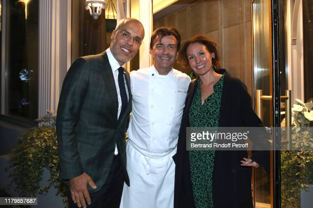 Chef Yannick Alleno standing between Kamel Mennour and his wife Annika Mennour the Inauguration evening of PavYllon a restaurant by Yannick Alleno at...
