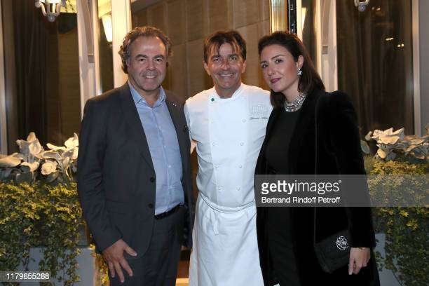 Chef Yannick Alleno standing between Politician Luc Chatel and his wife Mahnaz Hatami attend the Inauguration evening of PavYllon a restaurant by...