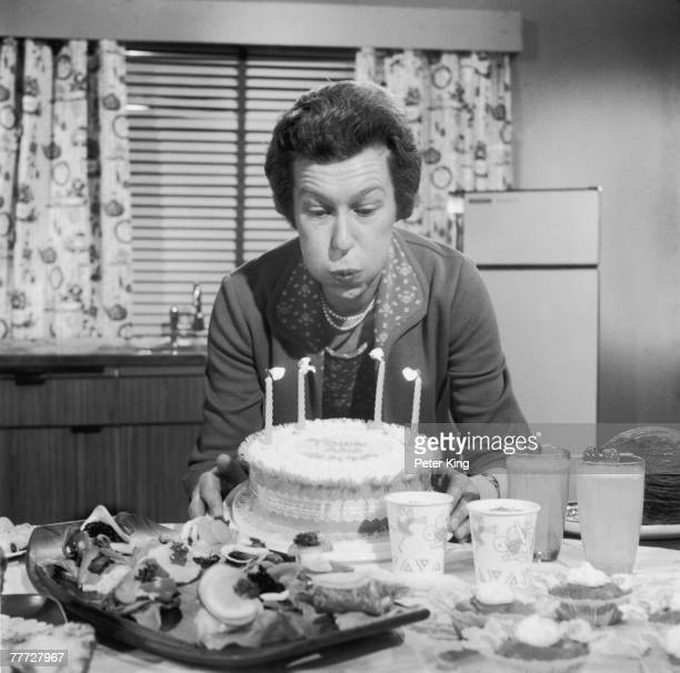 TV chef Zena Skinner celebrates the 4th anniversary of her cookery slot on the BBC programme 'Town and Around' by blowing out the candles on a cake...