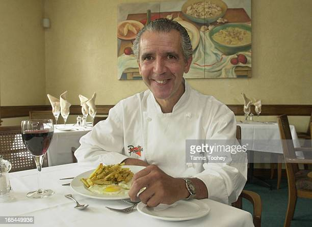 August 22001Executive Chef Piatto restaurant Fernando Garcia sits down for a late lunch of his favorite Spanish cuisine Huevos Estrelladostranslated...