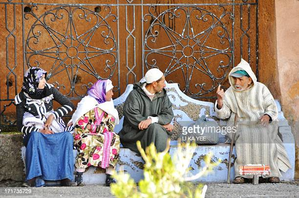 Chefchaouen, Morocco, local people talking to each others, relaxing day, morning after breakfast, 2011