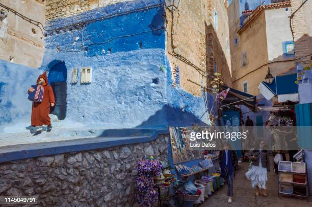 chefchaouen street scene - dafos stock photos and pictures
